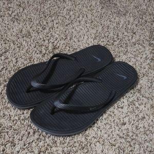 Nike flip flops.